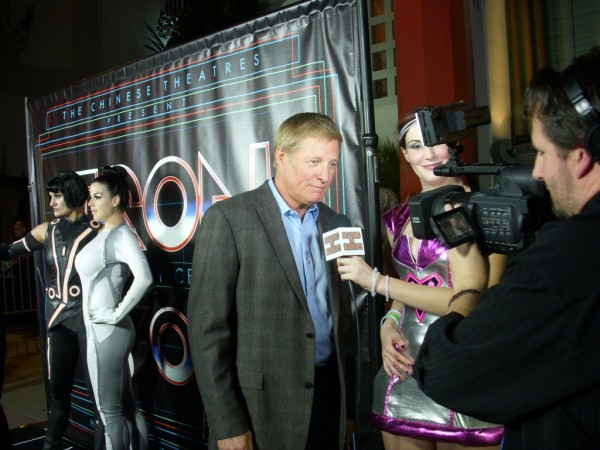 BTM Host Kat Sheridan chats with Bruce Boxleitner (aka TRON) on the GRID Carpet outside of Grauman's Chinese Theater's for the 30th Anniversary Celebration Event