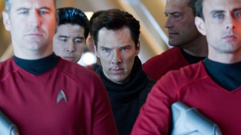 Kahn (Benedict Cumberbatch) (Ctr.) escorted by the Enterprise Crew