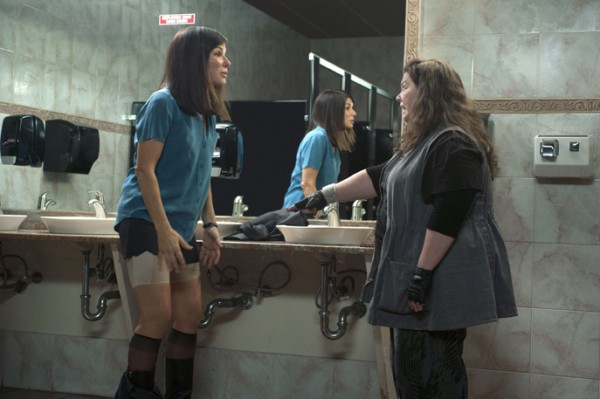 Special Agent Sarah Ashburn (Sandra Bullock) explains and displays the magic properties of Spanx to her new partner, Boston Detective Shannon Mullins (Melissa McCarthy), in THE HEAT