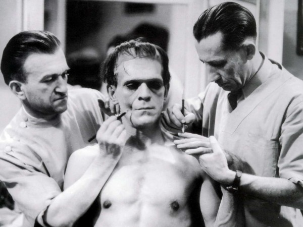 Jack Pierce and assistant build the makeup for Boris Karloff as Frankenstein's Monster.