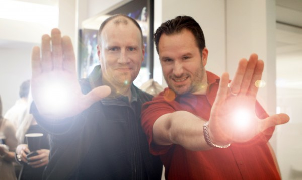 MARVEL Studios President Kevin Feige and BTM Host Steve Czarnecki fire their Repulsor Blasts during the Opening Day event for IRON MAN 3