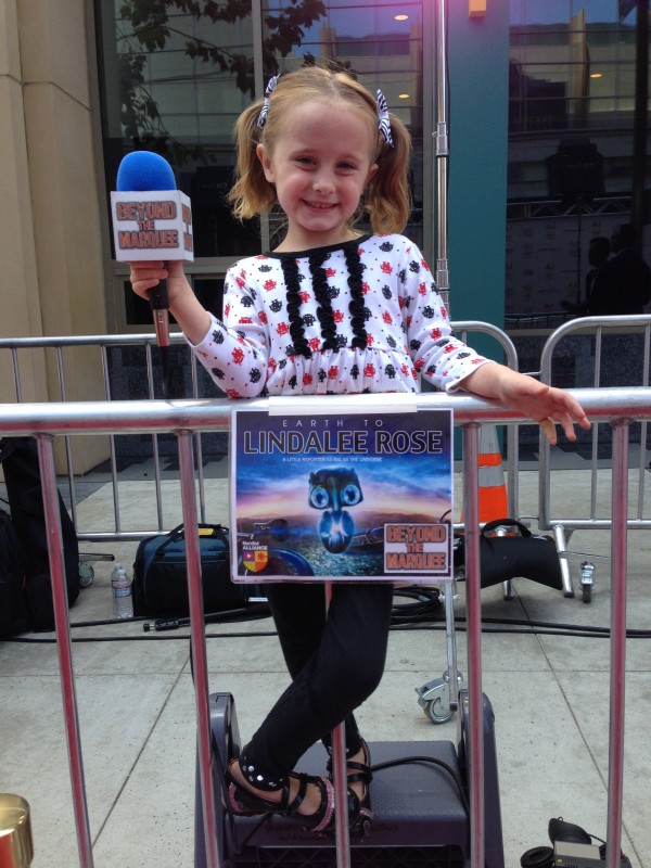 Lindalee stands ready with Microphone in hand for the arrivals of the EARHT TO ECHO Cast & Crew on the Red Carpet