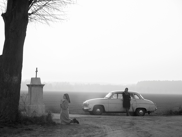 Black and white cinematography shows the bleak countryside