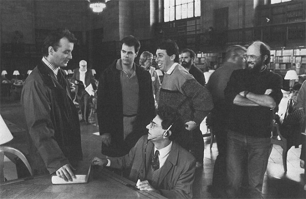 Ivan Reitman and Joe Medjuck share a laugh with the cast while shooting at New York Public Library.