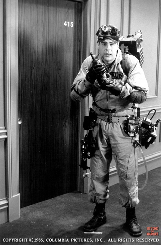 Dan Aykroyd (Ray Stantz) decked out in equipment