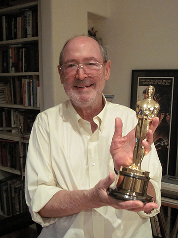 Stephen Dane in his studio holding his mother's Oscar® for 'Joan of Arc'
