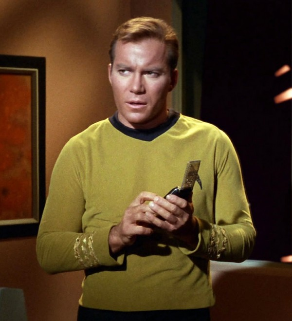 William Shatner as Captain James T. Kirk speaks into his communicator