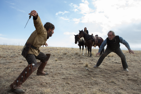 Tim Blake Nelson as The Freighter faces off against Tommy Lee Jones as George in THE HOMESMAN