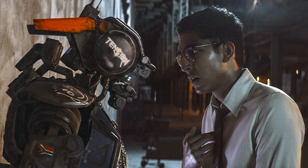"""Chappie with """"master"""" Dion (Dev Patel)"""