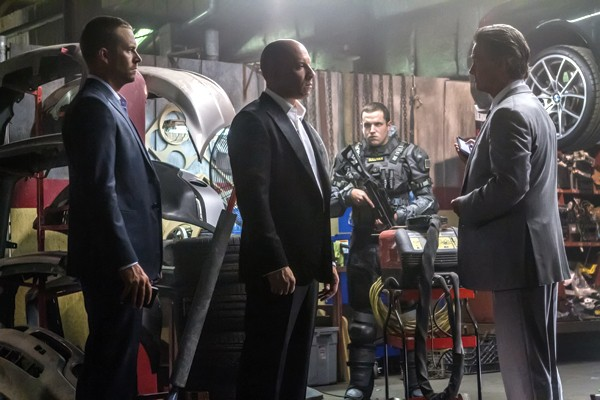 Brian (Paul Walker) and Dom (Vin Diesel) meet with a high-level government operative (Kurt Russell)