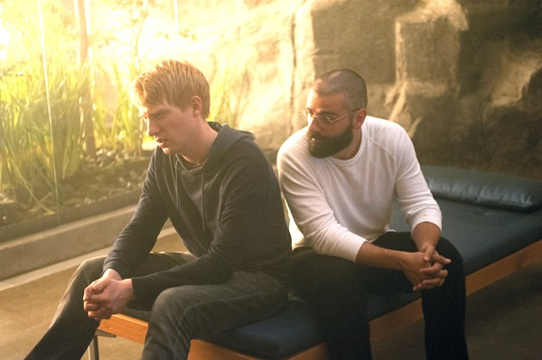 Caleb (Domhnall Gleeson), and Nathan (Oscar Issac) talk about their next move in Ex Machina