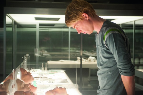 Caleb (Domhnall Gleeson) looks over some very realistic faces in Ex Machina