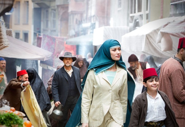 Connor is required to walk behind Ayshe (Olga Kurylenko) and her son at the Turkish market