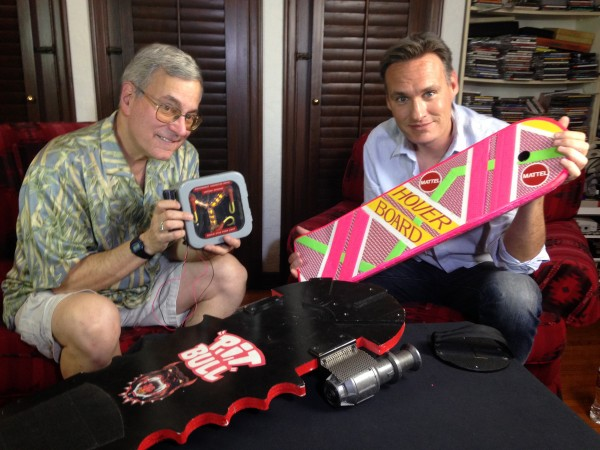 Bob Gale and Jon Donahue with some of the iconic film items from Bob Gale's personal Back to the Future trilogy prop collection