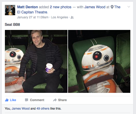 Matt Denton one of the the electronic design and development supervisors for the BB-8 droid in Star Wars: The Force Awakens, poses with the BB-8 seat at the El Captain theater in Hollywood.