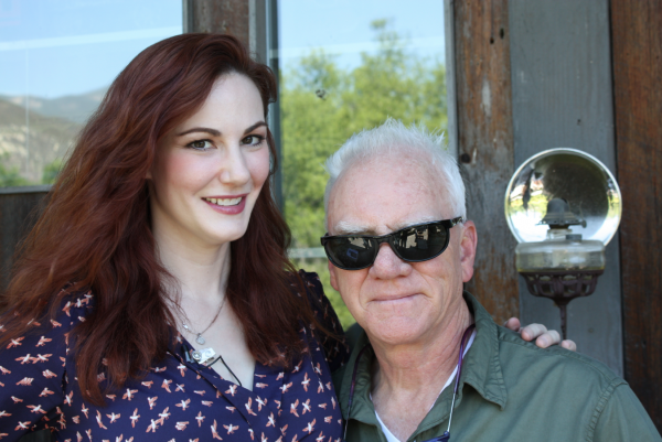 Host Kat Sheridan and celebrated actor, Malcolm McDowell, during a Beyond the Marquee interview at his California home.