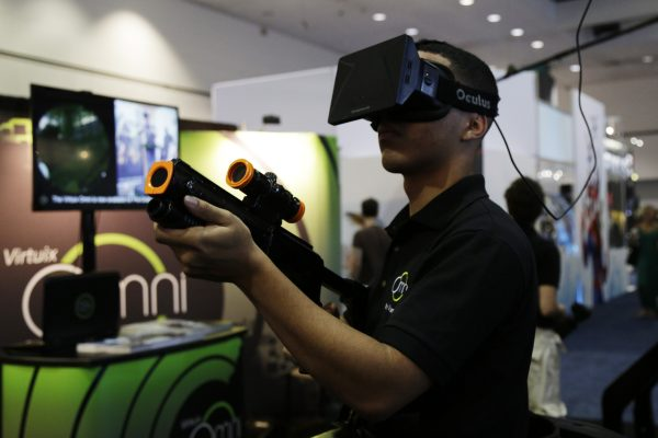 An E3 attendee tries out the Virtuix Oculus Rift and Omni Treadmill at E3 Electronic Entertainment Expo in Los Angeles, California. The annual video game conference and show runs June 10-12. (Photo by Dan R. Krauss/Getty Images)